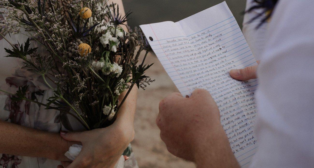 Groom reads from handwritten vows