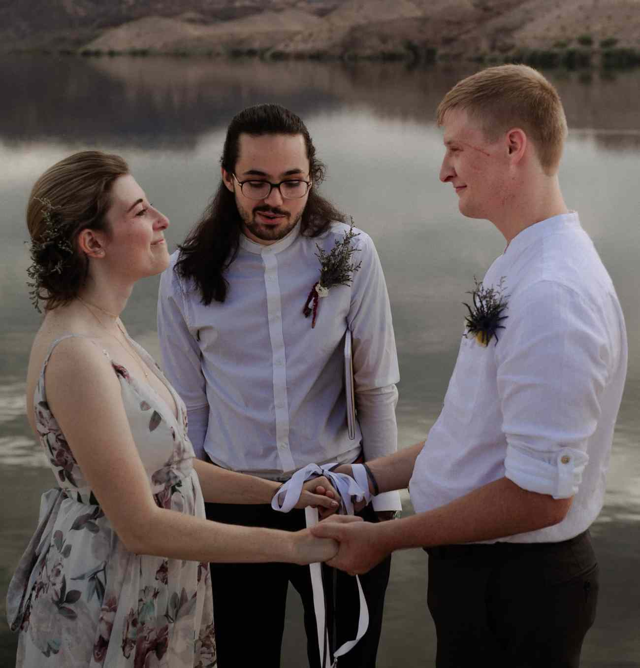 Bride and groom participate in hand-fasting ceremony at Nelson's Landing