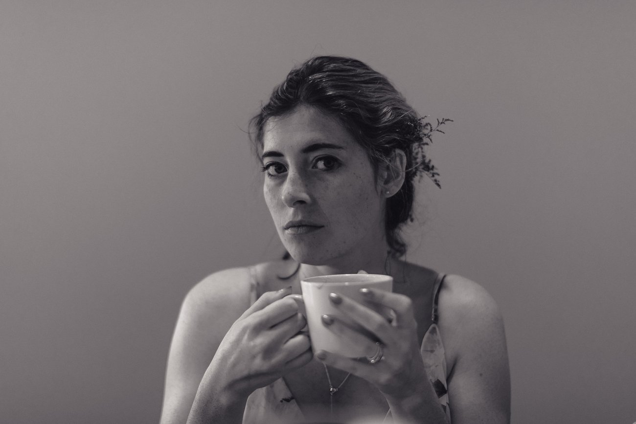 Bride drinking a mocha after her Las Vegas Elopement CRAFT Kitchen