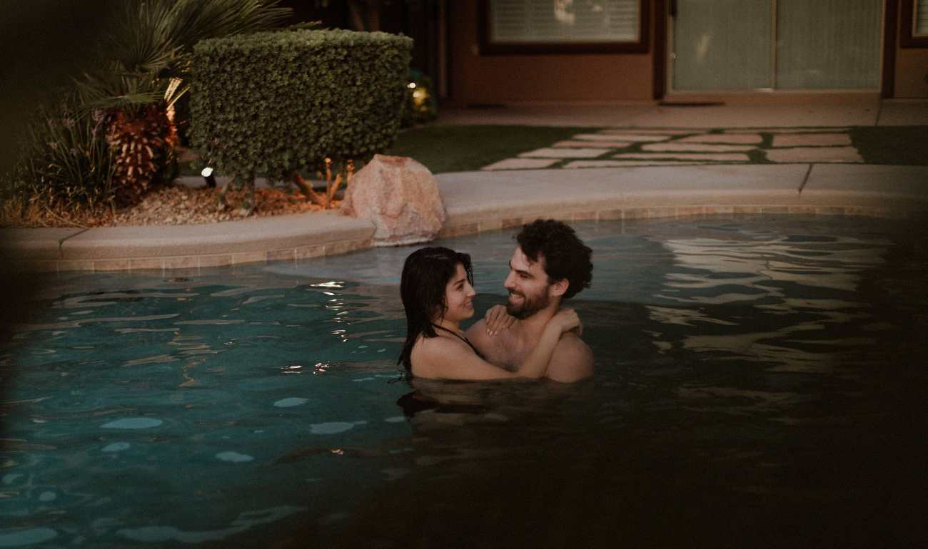 Moody Las Vegas couples session in the pool at sunset