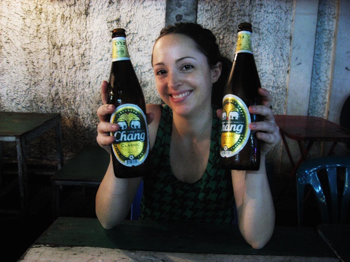 Flavia in Bangkok, with a Chang beer