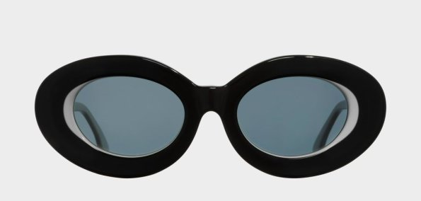 Vintage, oversized oval pair of summer sunglasses featuring a monochrome colorway and tapered temples. Circa mid 00's by Cutler and Gross