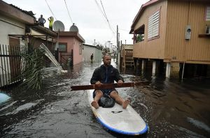 Man escaping the flooding in Puerto Rico