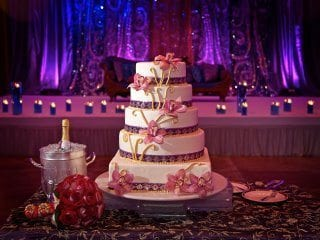 Beautiful Wedding Cake with pin spot lighting and uplighting back drop