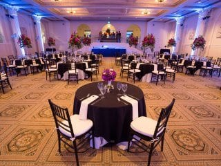Medium size wedding reception with limited uplighting blue