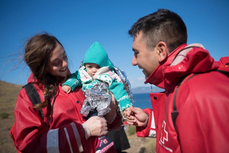Red Cross volunteers helping refugees on Lesbos