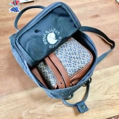 Purse in mini backpack.
