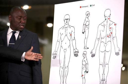Attorney Ben Crump looks at a diagram showing gunshot wounds to Stephon Clark during a news conference at the Southside Christian Center on March 30, 2018 in Sacramento, California. The legal team for the family of Stephon Clark, who was shot and killed by Sacramento police, held a news conference to announce their findings of an independent autopsy performed by renowned forensic pathologist Dr. Bennet Omalu. The autopsy showed that Clark was shot eight times.  [Justin Sullivan/Getty Images]