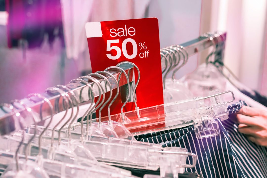 50% off sale in store with clothing rack