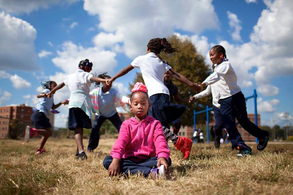 child-meditating-playground