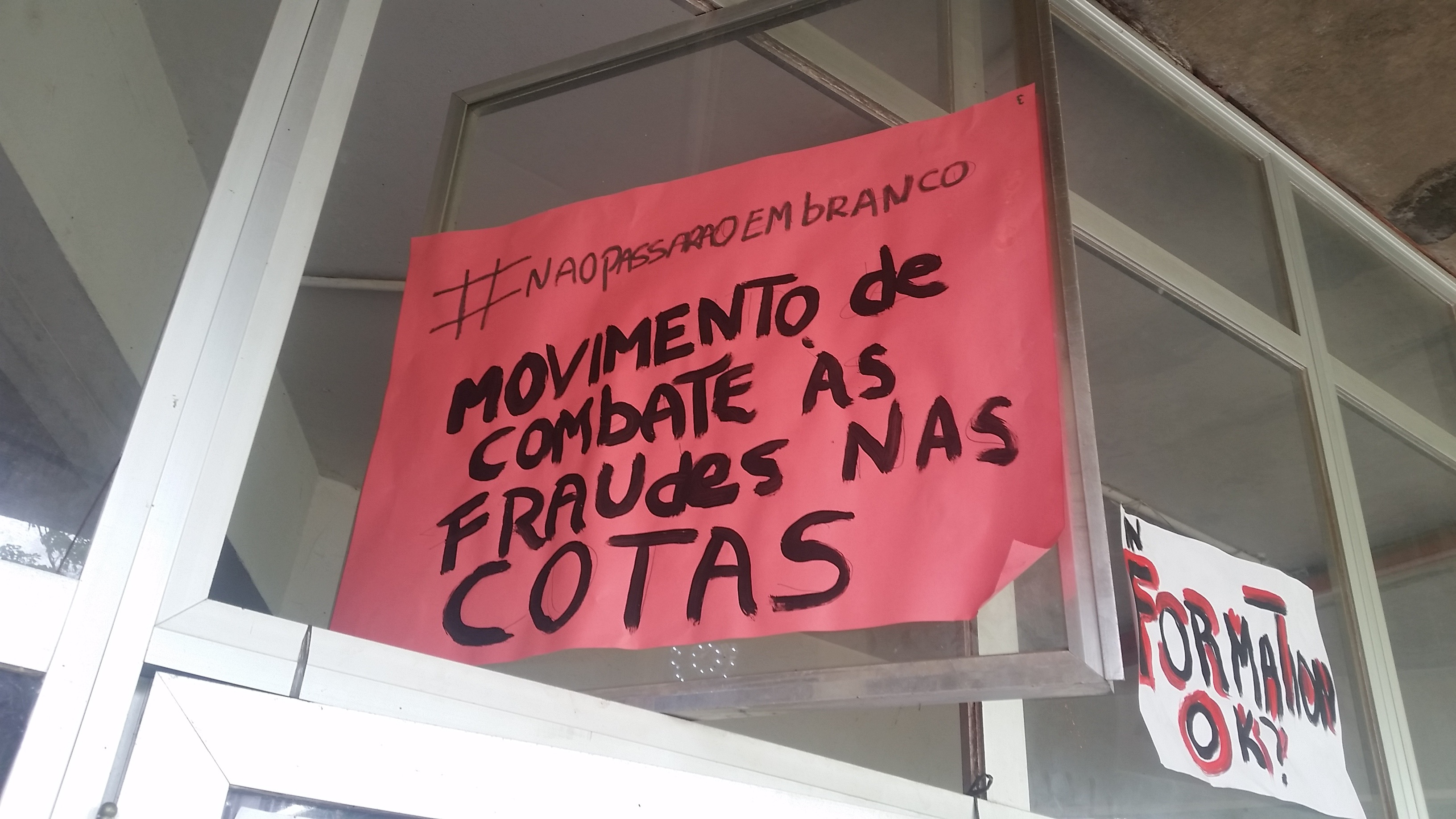"A sign hung outside the QuIlombo reads ""Movement to combat fraud in the quotas"" (Photo by Kristian Davis Bailey)"
