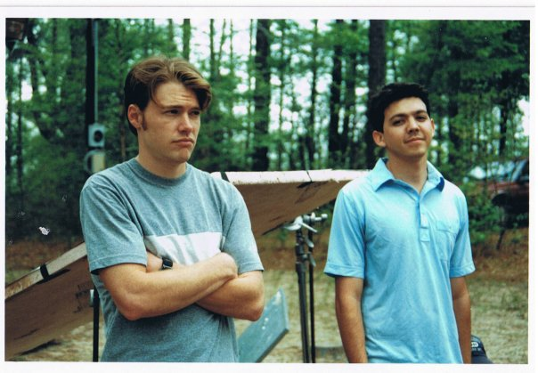 Two crew members of the short film, The Land, stand by on the movie set