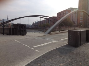 This bridge, Niederbaumbrücke, leads to the historic docklands of Hamburg, a UNESCO world heritage site. Even here you've got steel barriers that can be shut at short notice. If this solution is good enough for UNESCO, it should DAMN WELL be good enough for Cork!