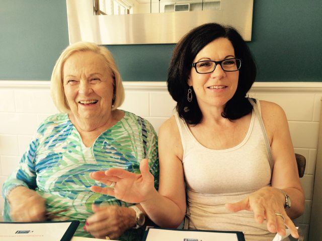 Mom and Nancy laughing at lunch in Palm Beach