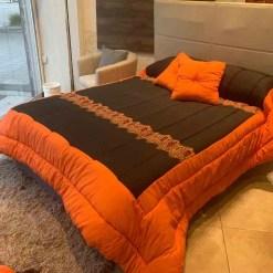 acolchado tapiceria lorenzo negro y naranja