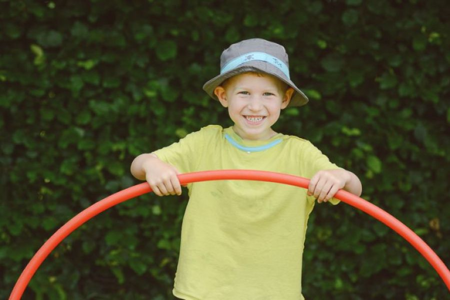 dorset school photography and lifestyle son holding hoop