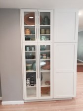 Full Height Glass Paned Cabinetry and Euro Style Long Pulls