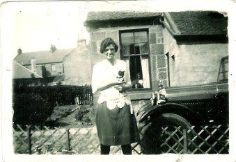 1928 Mary Danskin at Danskins shop, Stonefield Cres