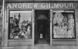 1910s Child stands in the doorway of Gilmours Drapers