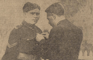 1916 JB Struthers pins the DCM on Arthur McAnulty at Auchentibber