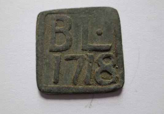 1718 Communion token Blantyre Parish Church at Kirkton