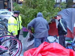 Police combed through the tend of an alleged drug dealer at Occupy Boston (Blast Staff photo/John Stephen Dwyer)