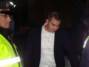 """The arrest of this man accused of striking a female activist in the face spurred a round of jests about how """"white guys in suits"""" should be profiled as dangerous individuals. (Blast Staff photo/John Stephen Dwyer)"""