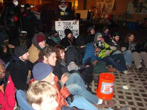 Defiantly seated in the same area that Occupy Boston held its General Assemblies, these activists mic checked various messages before being arrested. (Blast Staff photo/John Stephen Dwyer)