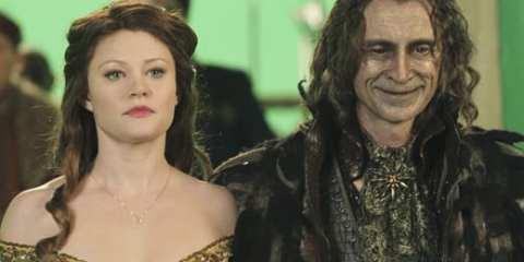 Rumpelstiltskin (Robert Carlyle) whisks his new housekeeper Belle (guest Emile de Ravin) away from her father.