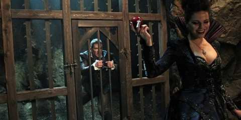 The Evil Queen (Lana Parilla) teases Charming (Josh Dallas) by showing him her secret weapon: a poisoned apple.