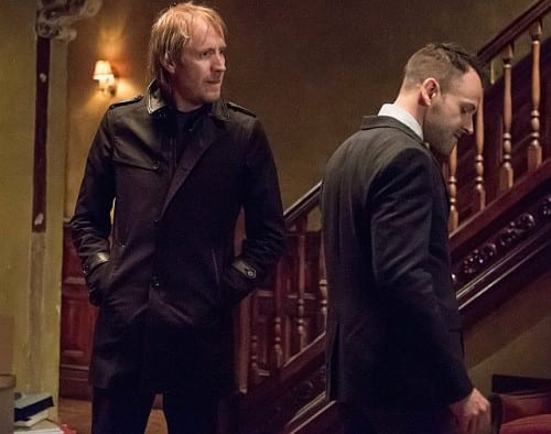 Sherlock (Jonny Lee Miller) and Mycroft (Rhys Ifans) race against the clock to find Joan (Lucy Liu).