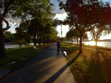 Esplanade: Marina and I biking home from work in Cambridge last summer. I got to practice some one-handed cycling!