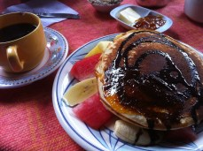 Breakfast: chocolate pancake over fresh fruit, served with the best cafe con leche I have ever tried.