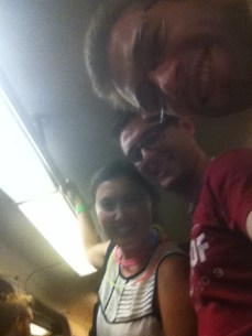 Aaron, Charlie, and I on the Green Line home sporting glowsticks and joy.