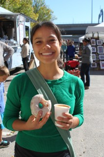Leanne with her vanilla bean donut and espresso