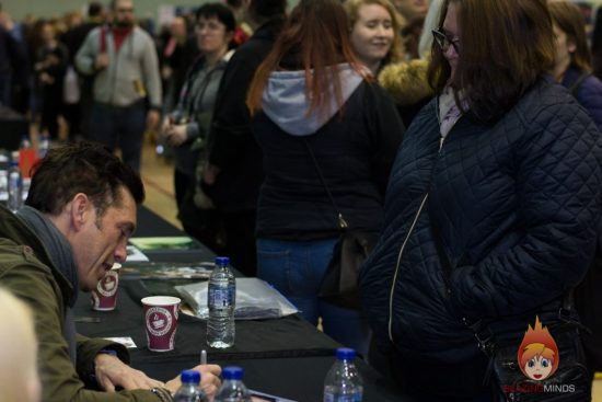 Royd Tolkien signs his photograph for Chrissie Wood at Wales Comic Con 2017 (Photo Karen Woodham/BlazingMinds)