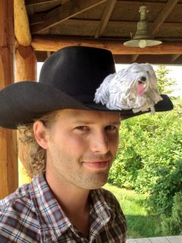 On Kerry James's cowboy hat. Kerry plays Caleb on CBC TV's Heartland.