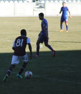 Forward Marvin Chavez controlling the ball. Nathan Sturgis #24 and Shane O'Neill #27 (back)