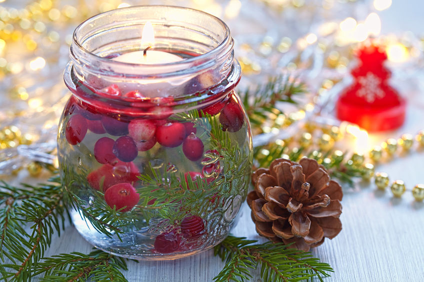 Mason Jar with candle, cranberries, and fir