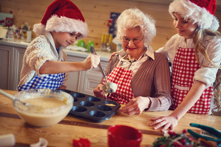Grandmother and grandchildren baking