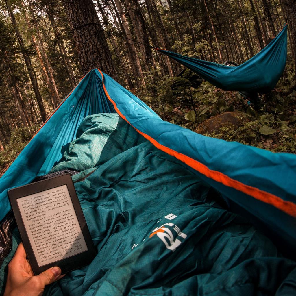 Campers resting in ultralight sleeping hammock tents