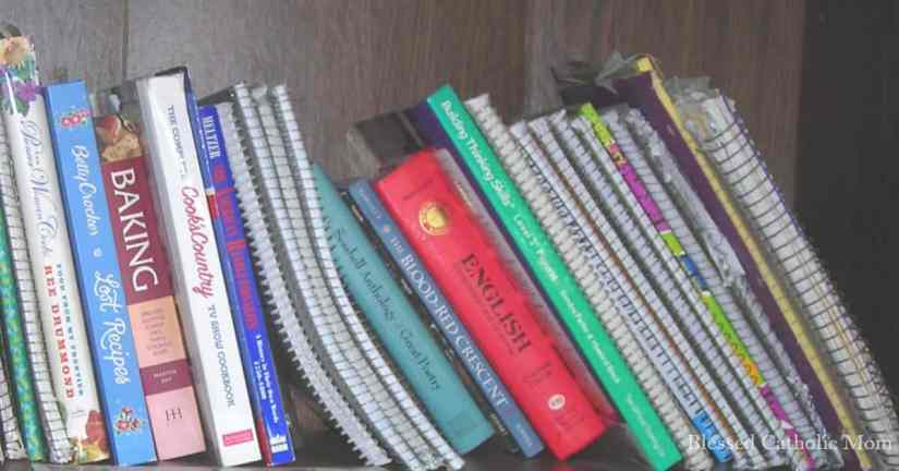 Conquer clutter in two easy steps. Image of a neat and organized shelf of books and notebooks.