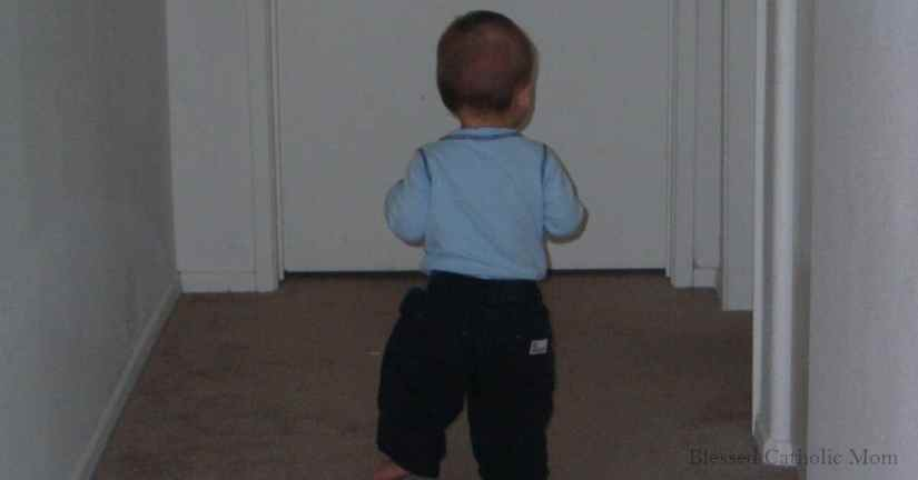 Keep track of milestones by writing them down on the calendar. Image of a toddler boy walking down a hallway.
