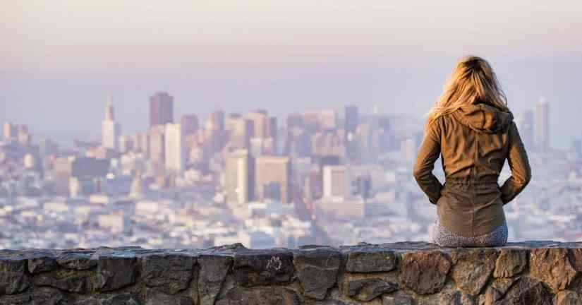 What is my purpose as a child of God and as a unique individual? Take tie time to discover God's gifts and plans for me. Image of a young woman sitting on a stone wall overlooking the city of San Francisco. Image credit picjumbo.