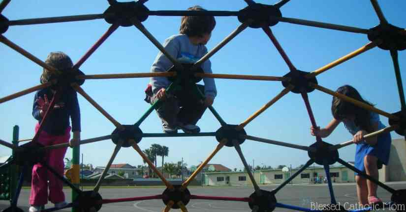 Being a great mom does not equal being a perfect mom. I can rely on God's help and work to be a great mom. Image of three kids on a piece of playground equipment.