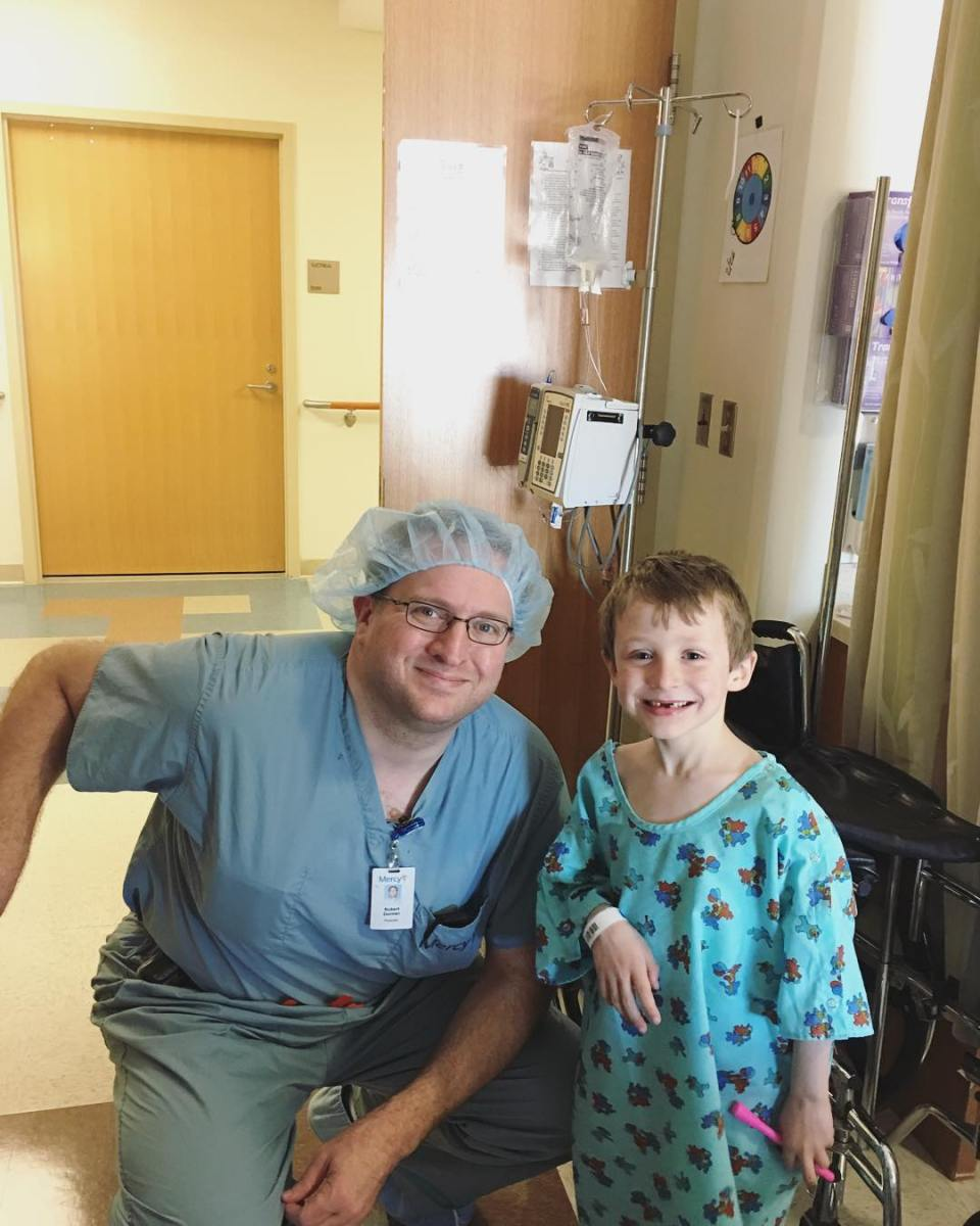 With his surgeon before we were discharged, his smile is back!