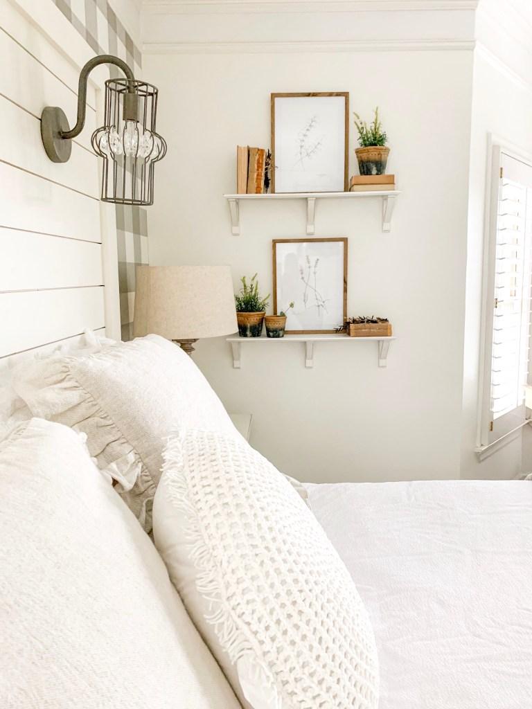 set of shelves with botanical prints books and plant decor