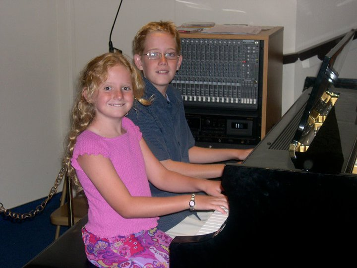 brother and sister at piano