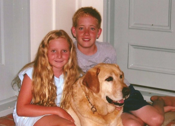 blond brother and sister with yellow lab