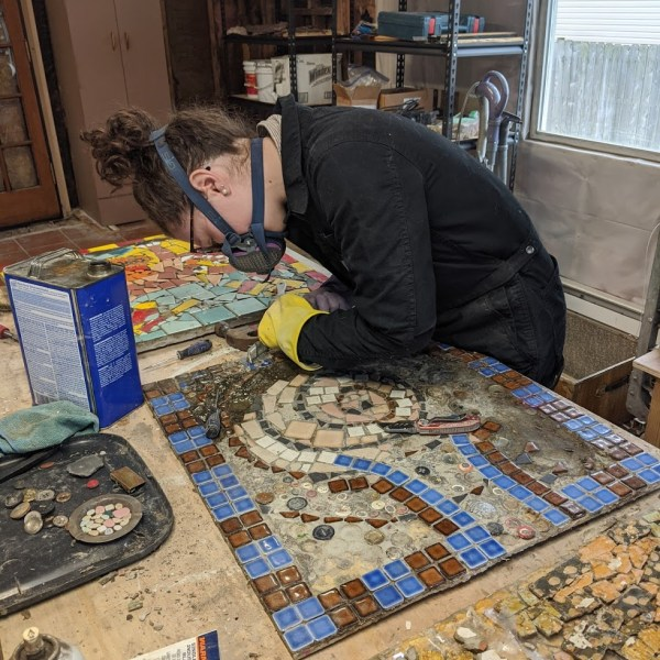 A Blind Eye teammember restoring one of the larger sections of the floor mosaic
